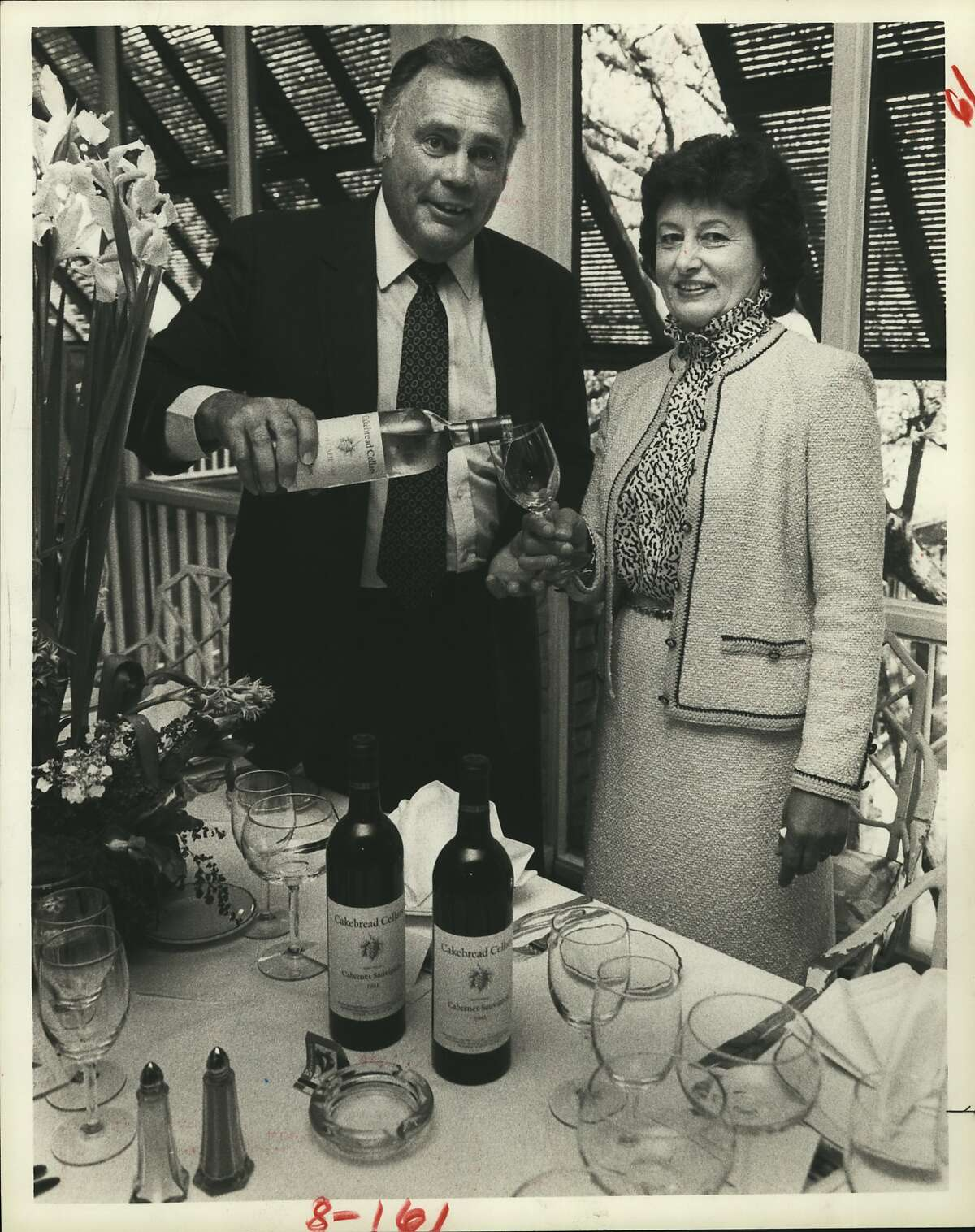 Jack Cakebread of Cakebread Cellars pours a glass of commemorative Decade Sauvignon Blanc for wife Dolores in 1984.
