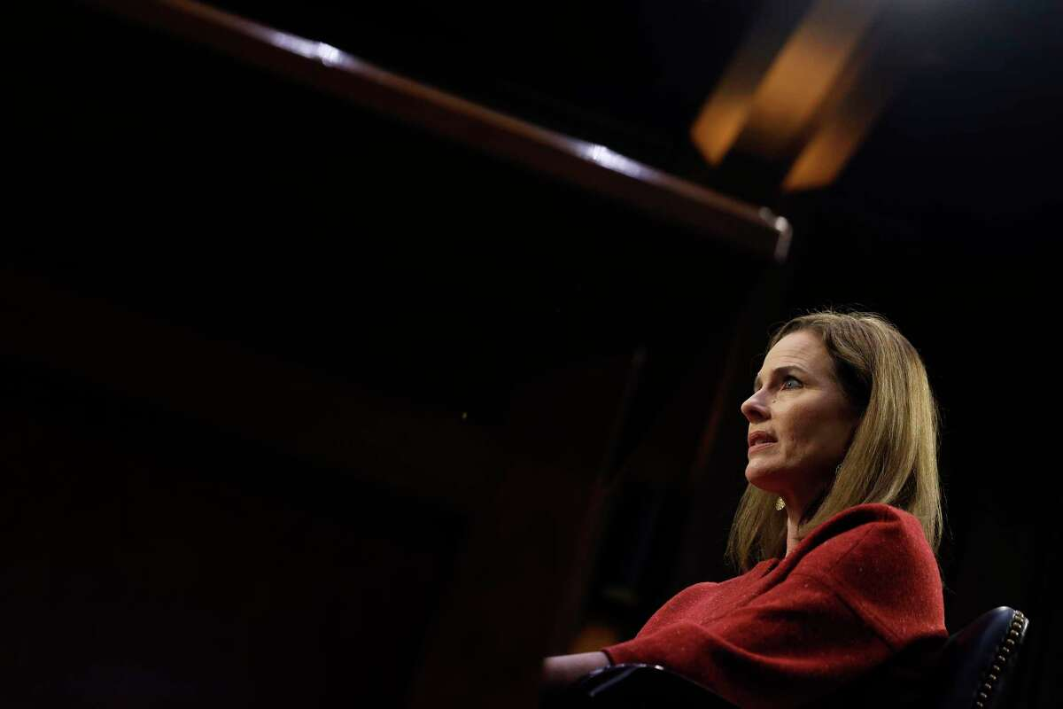 WASHINGTON, DC - OCTOBER 13: Supreme Court nominee Judge Amy Coney Barrett testifies before the Senate Judiciary Committee on the second day of her Supreme Court confirmation hearing on Capitol Hill on October 13, 2020 in Washington, DC. Barrett was nominated by President Donald Trump to fill the vacancy left by Justice Ruth Bader Ginsburg who passed away in September. (Photo by Samuel Corum/Getty Images)