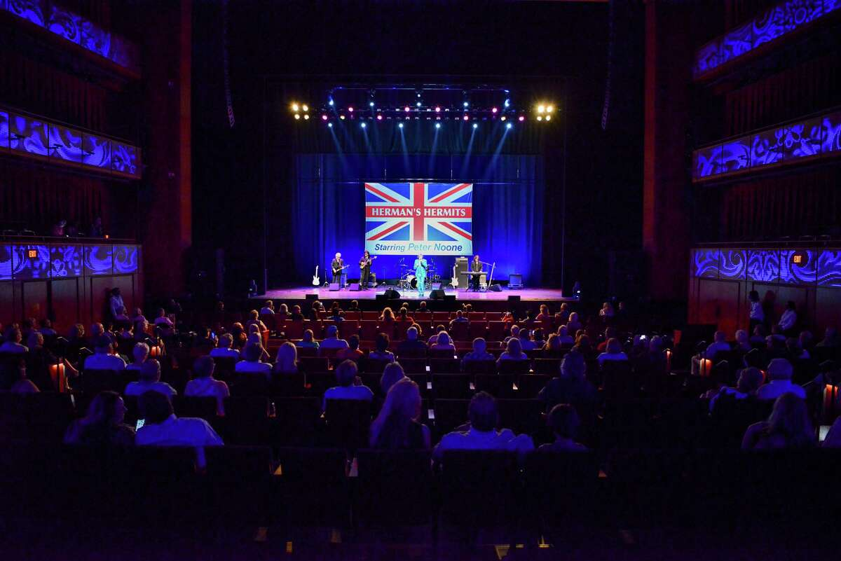Concert-goers are socially distanced during a Herman's Hermits starring Peter Noone show at the Tobin Center.