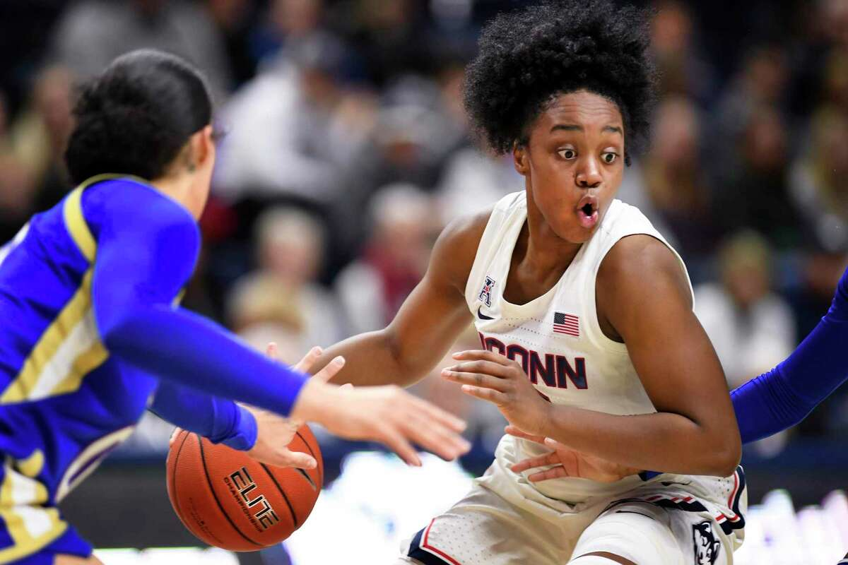 UConn's Christyn Williams keeps the ball against Tulsa during a game last season in Storrs.