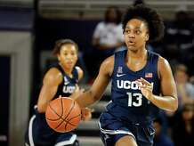 Connecticut's Christyn Williams (13) brings the ball up the court against East Carolina during the first half of an NCAA college basketball game, Saturday, Jan. 25, 2020 in Greenville, N.C. (AP Photo/Karl B DeBlaker)