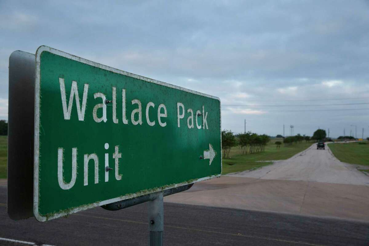 A road sign pointing to the Wallace Pack Unit is seen at dawn on Wednesday, Aug. 9, 2017, in Navasota. ( Yi-Chin Lee / Houston Chronicle )