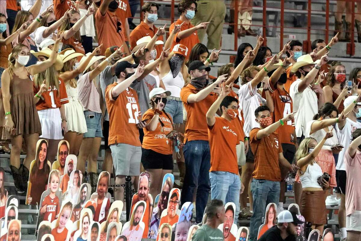 """Texas fans sing """"The Eyes Of Texas"""" after an NCAA college football game between Texas and UTEP in Austin, Texas, Saturday, Sept. 12, 2020. (AP Photo/Chuck Burton)"""