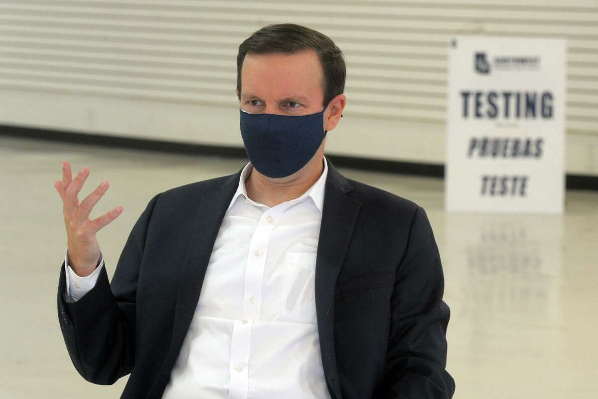 U.S. Sen. Chris Murphy speaks during a meeting with representatives from Southwest Community Health Center in a former retail space currently being converted into a new COVID-19 testing facility, in Bridgeport, Conn. Oct. 13, 2020.