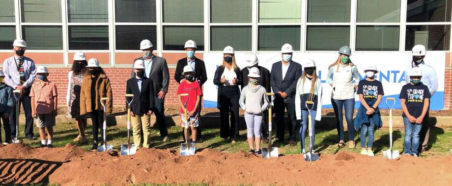 Town and school officials joined with some students to consecrate the groundbreaking of the Mill Hill renovation project. Photo: / Brenda Kupchick / Contributed