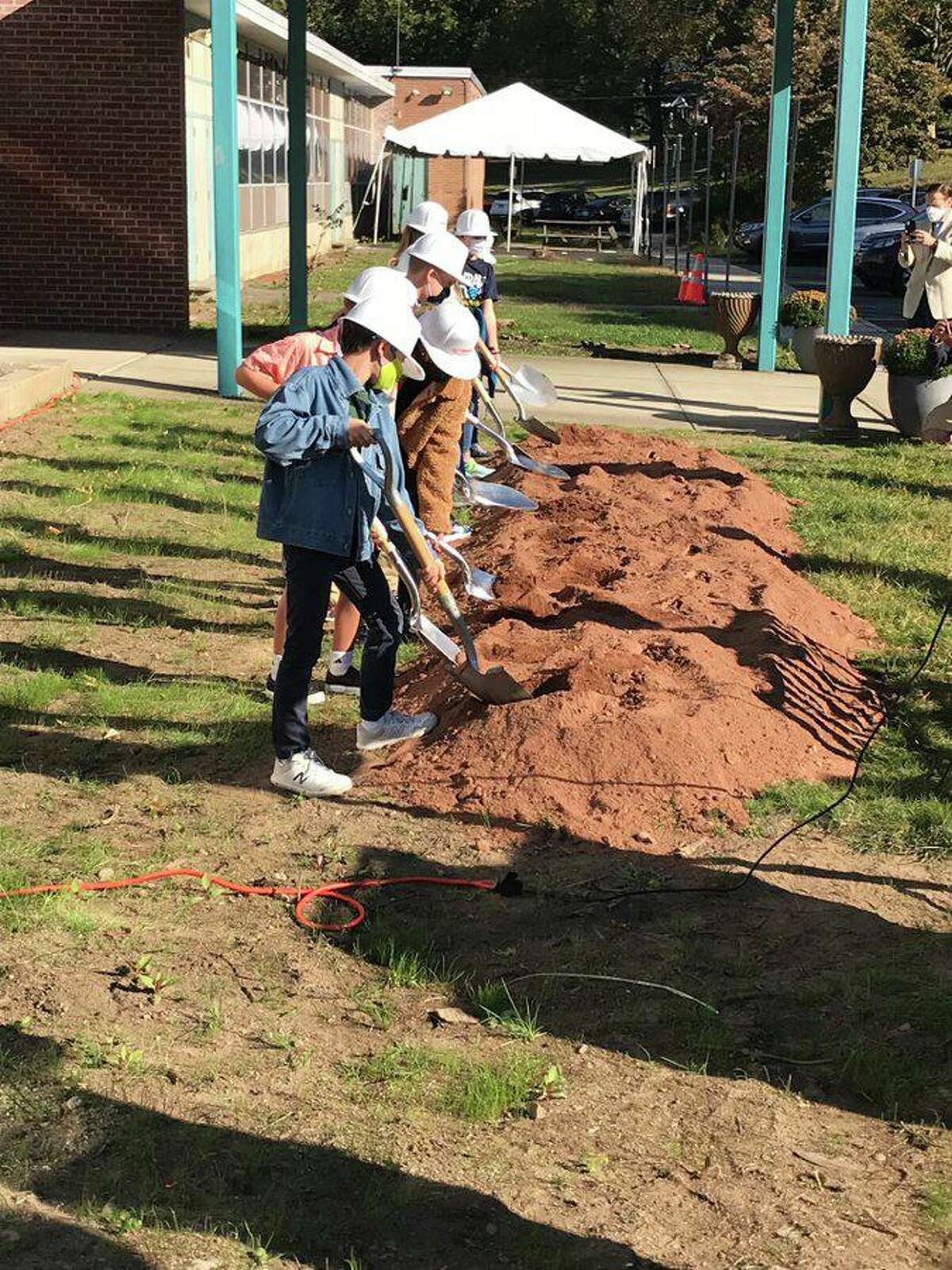 Students take part in the groundbreaking ceremony at Mill Hill Elementary School.