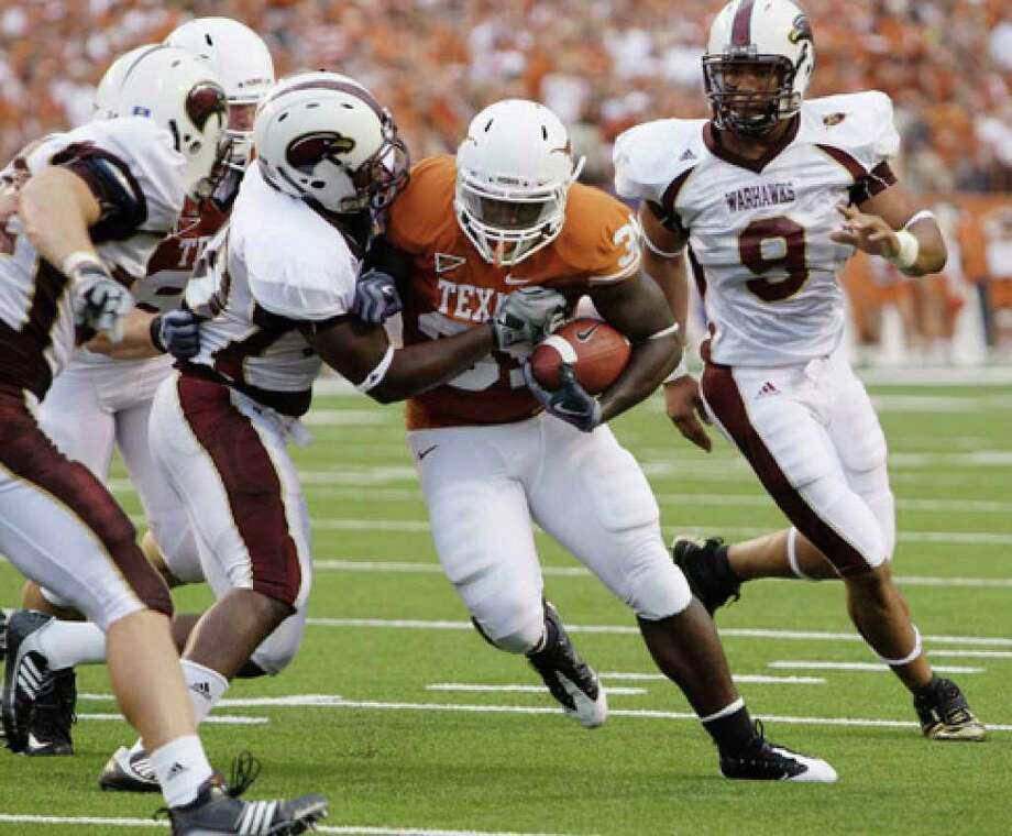 Texas' Cody Johnson, trying to plow through Louisiana-Monroe defenders last season, has impressed his coaches.