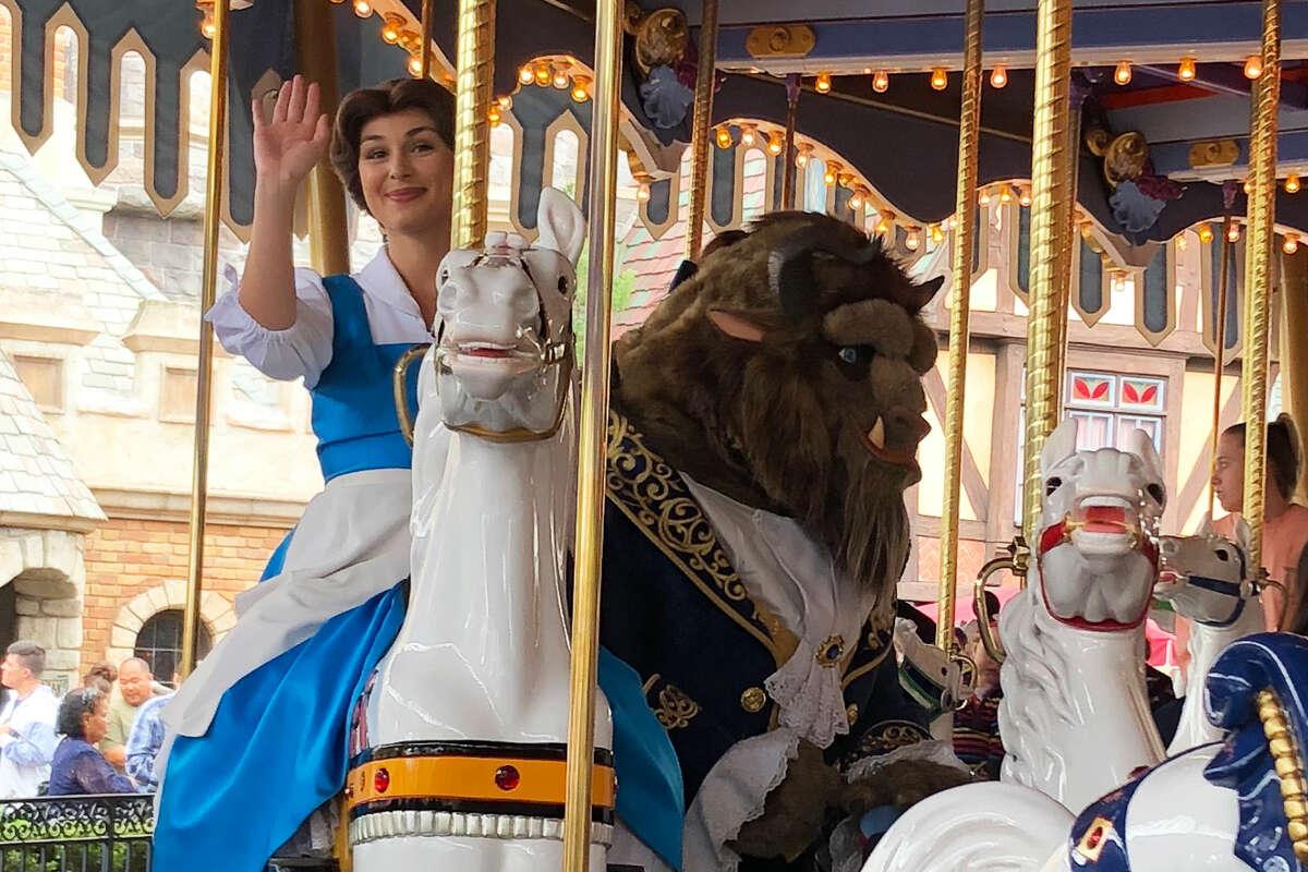 Belle and Beast on King Arthur's Carousel in Disneyland.