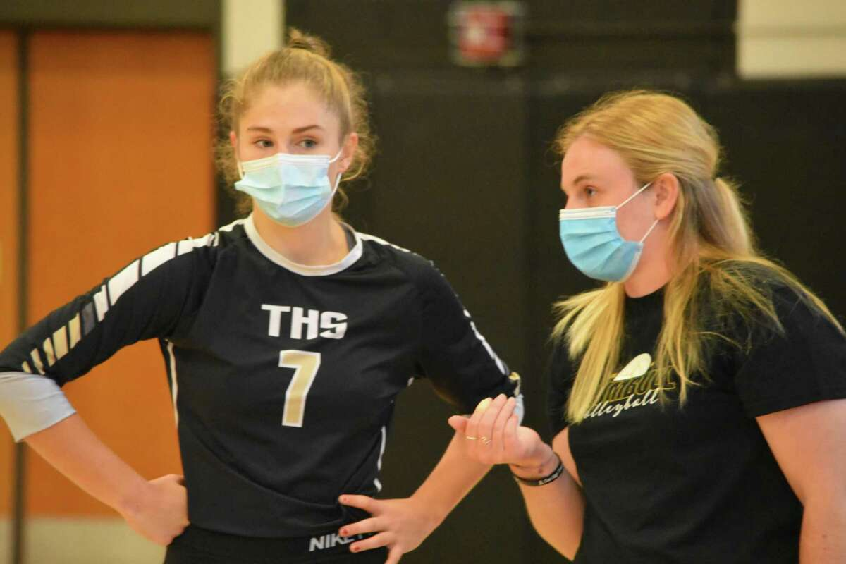 Trumbull coach Nicole Trommelen talks to Ada Sadlier during the volleyball match against Fairfield Ludlowe on Tuesday, October 13, 2020.