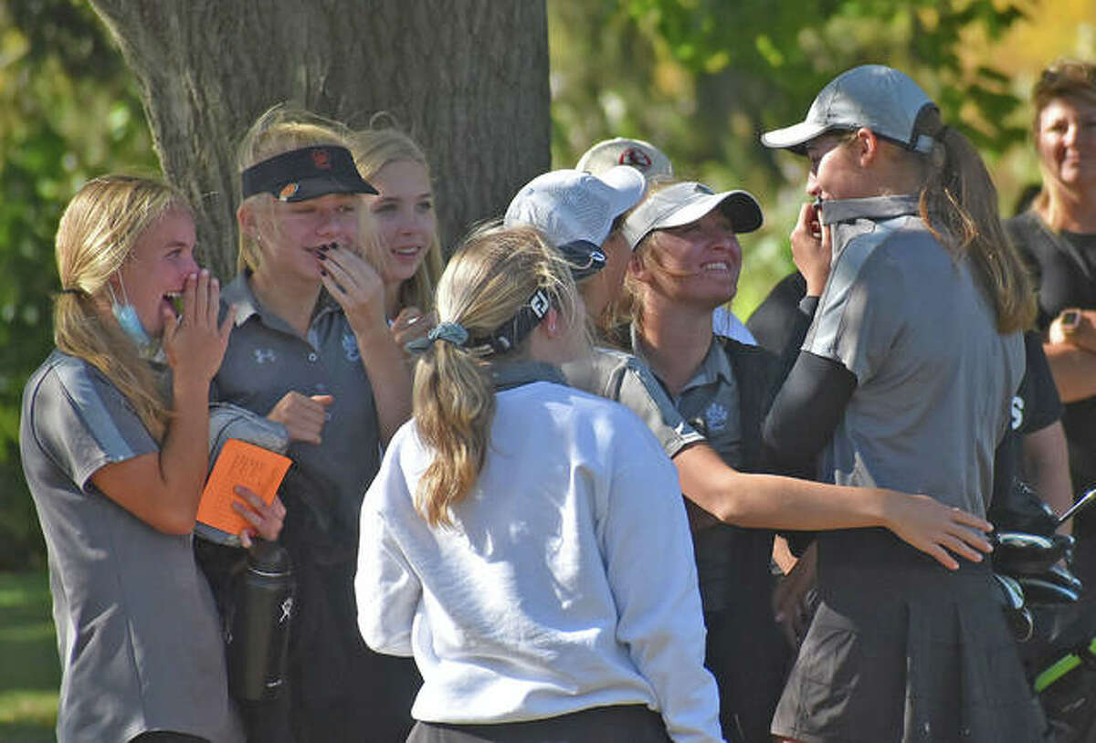 Edwardsville sophomore Nicole Johnson, right, is congratulated by her teammates after winning medalist honors at the Class 2A Champaign Centennial Sectional at the University of Illinois Golf Course on Tuesday in Savoy.