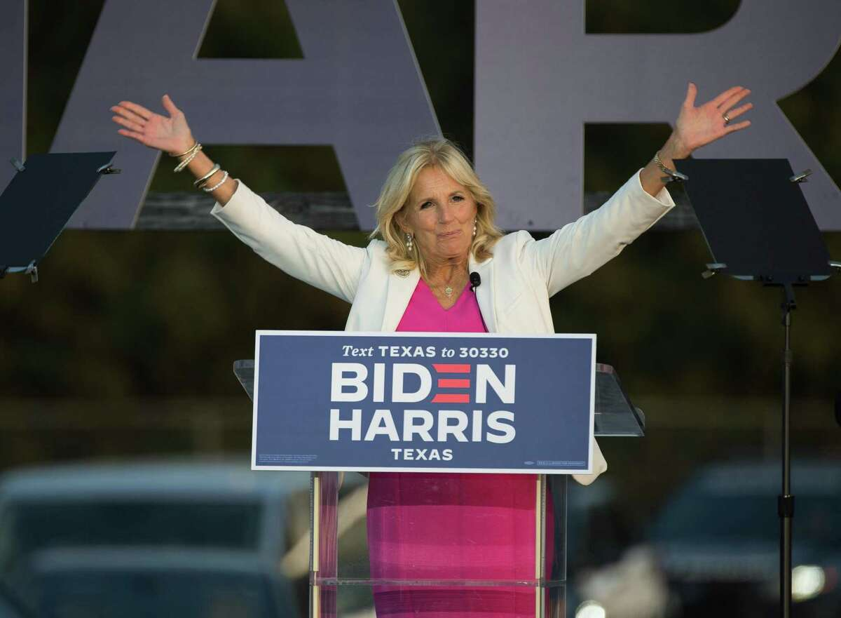 Dr. Jill Biden, wife of Joe Biden, waves at supporters before speaking at the Get Out the Vote event Tuesday, Oct. 13, 2020, at NRG Stadium parking lot in Houston.
