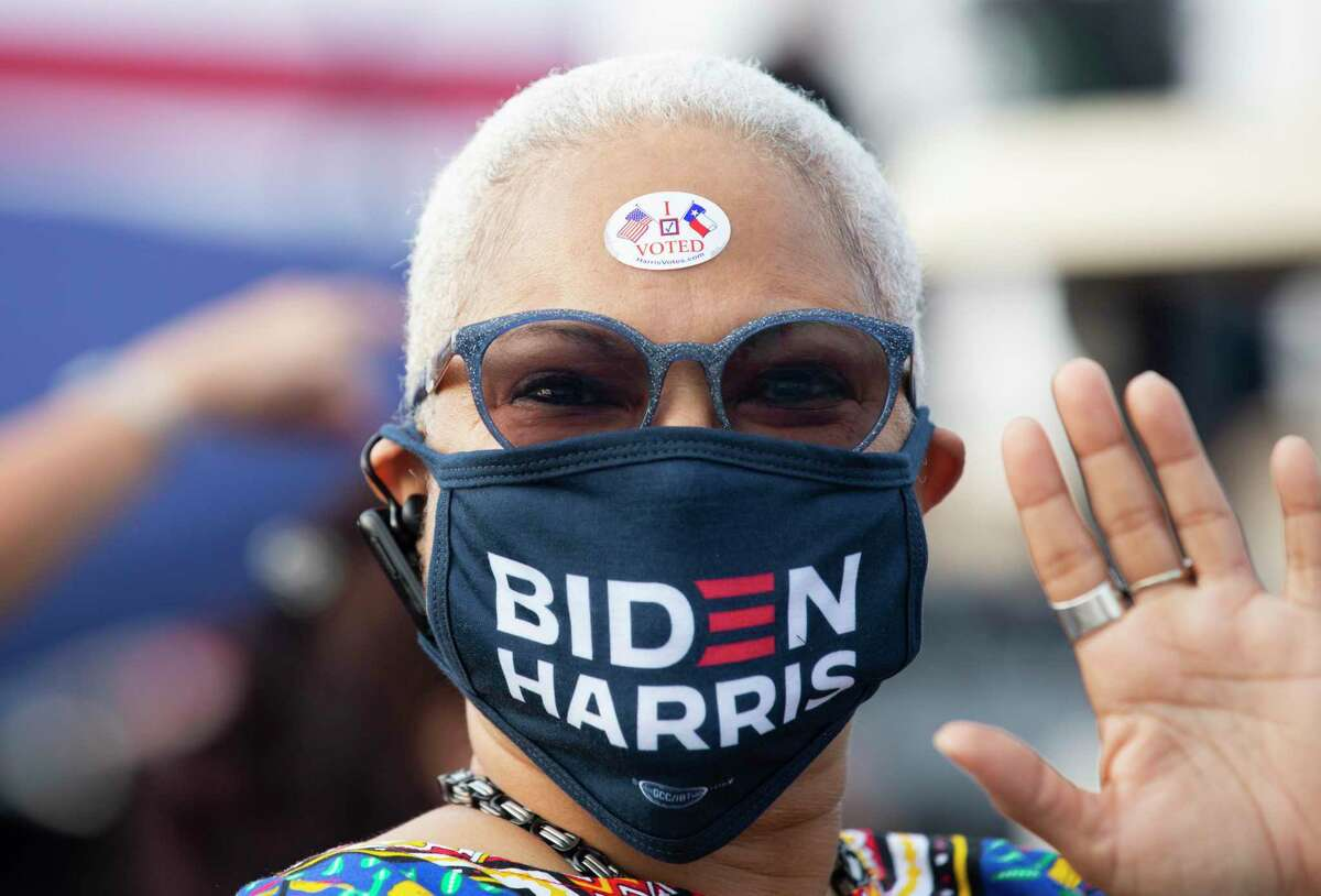 """Rebecca Fagan wears a """"I Voted"""" sticker to participate the Get out the Vote event Tuesday, Oct. 13, 2020, at NRG Stadium in Houston."""