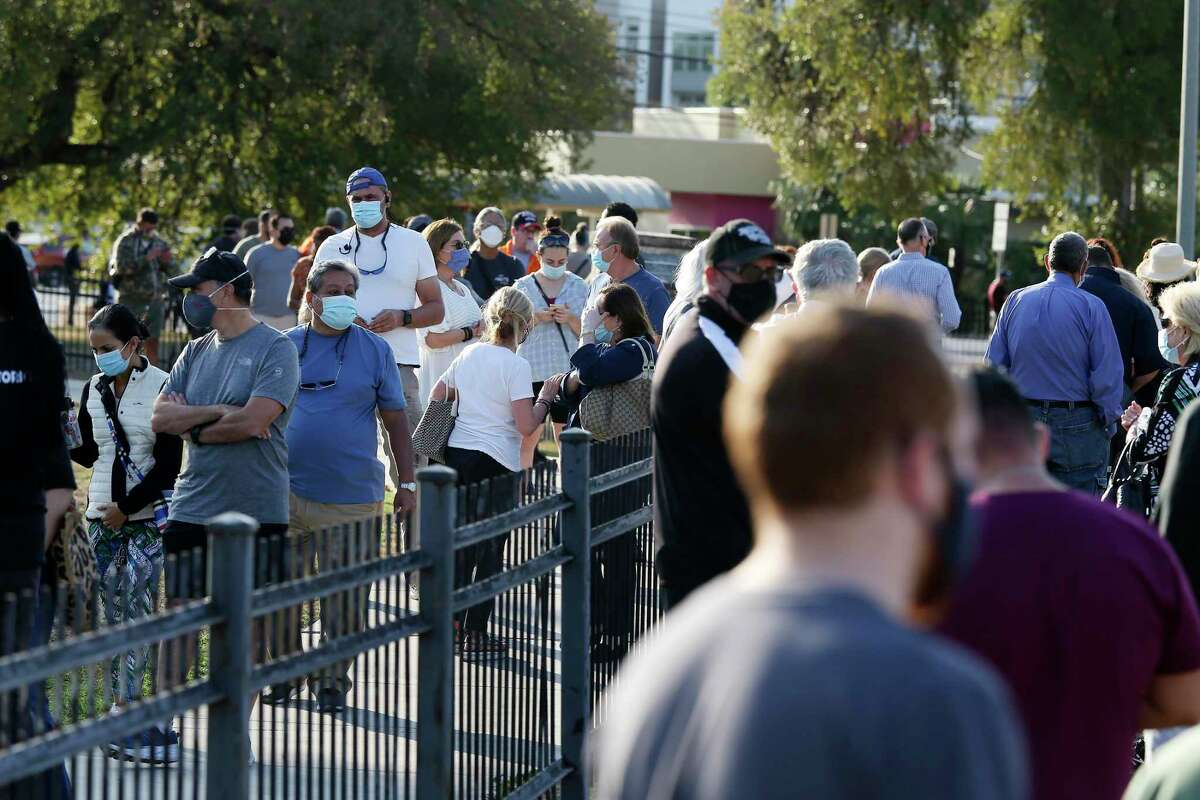 A long line forms around Lions Field polling site on the first day of early voting, Tuesday, Oct. 13, 2020.