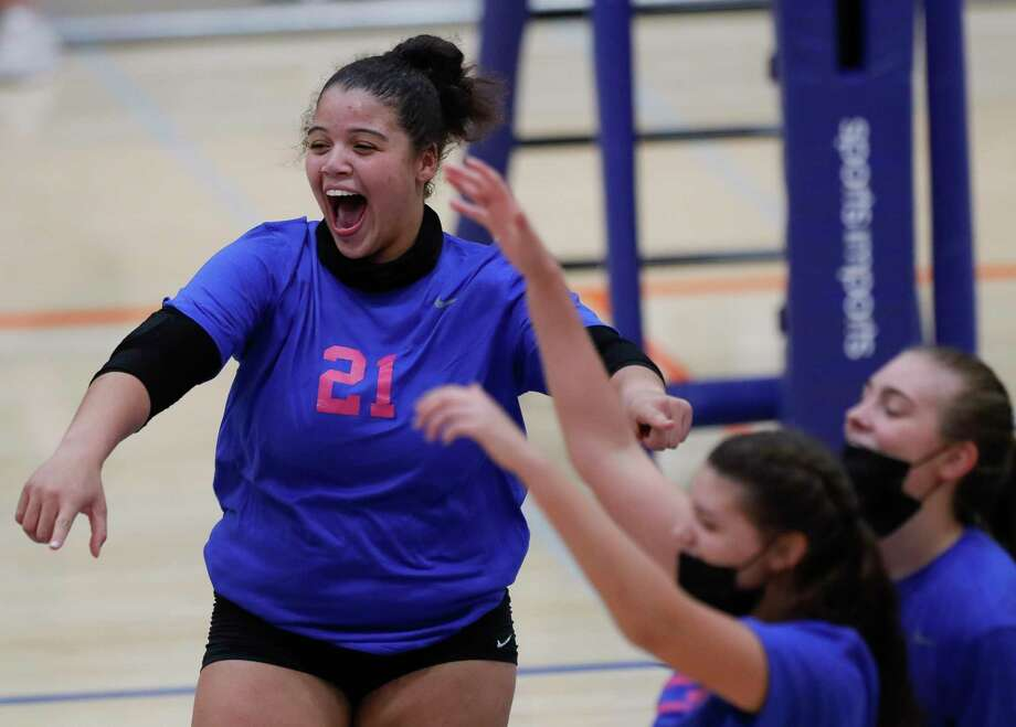 Grand Oaks outside hitter Fallon Thompson (21) reacts after scoring a point during the third set of a District 13-6A high school volleyball match at Grand Oaks High School, Tuesday, Oct. 13, 2020, in Spring. Grand Oaks swept College Park in straight sets. Photo: Jason Fochtman, Houston Chronicle / Staff Photographer / 2020 © Houston Chronicle