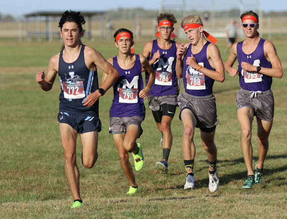 Jersey's Cole Martinez (left) is pursued Mascoutah's (from left) Sam LaJoye, Jordan Eddy, Noah Jensen and Avery Cozzi in the second mile of the Mississippi Valley Conference cross country meet Tuesday afternoon at Mascoutah Middle School. All five runners finished in the top eight. Photo: Greg Shashack | The Telegraph