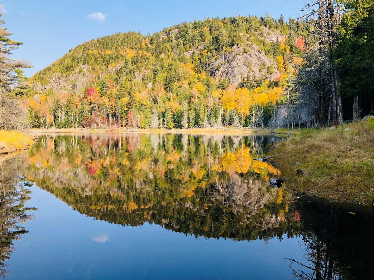 The morning sun and clear skies allowed for a nice reflection in the pond as we began our October 10 trek up Giant Mountain in Keene, by Jon Rocco
