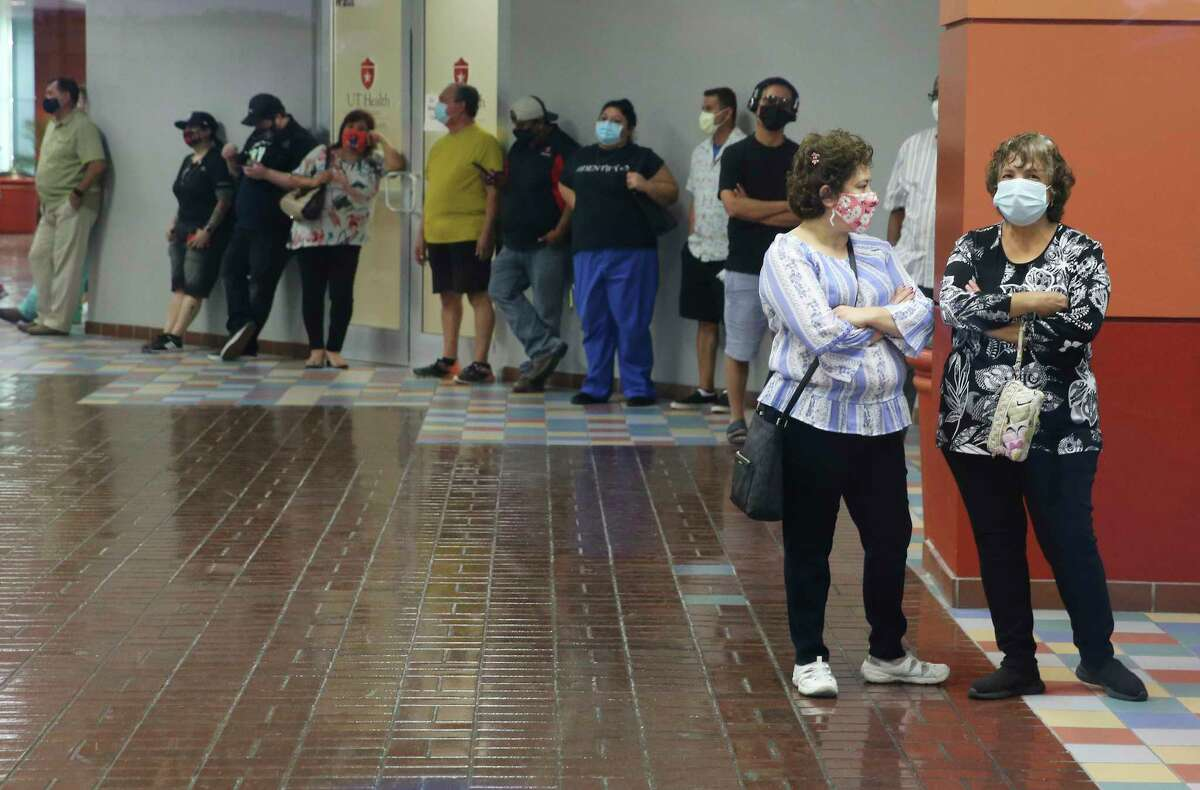 People continue to wait in line - some for several hours - even after the polling site had closed at Wonderland Mall on Tuesday, Oct. 13, 2020.