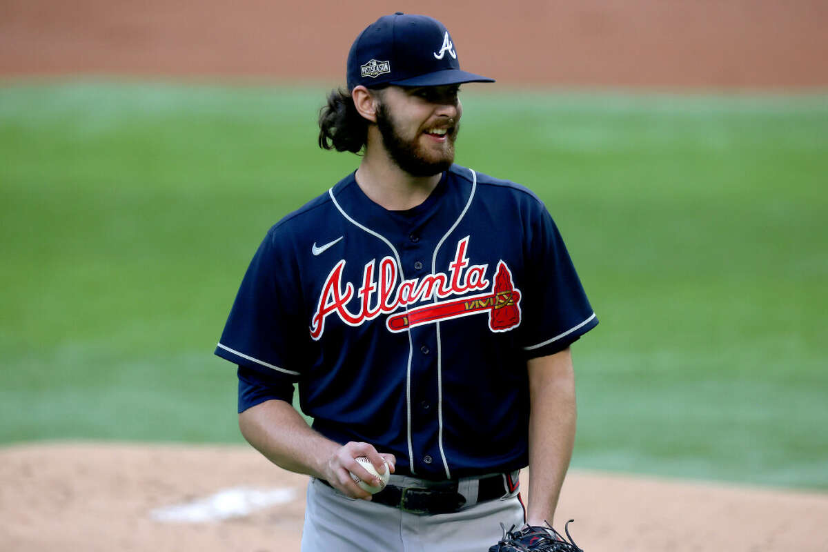 Ian Anderson #48 of the Atlanta Braves reacts against the Los Angeles Dodgers during the first inning in Game Two of the National League Championship Series at Globe Life Field on October 13, 2020 in Arlington, Texas.