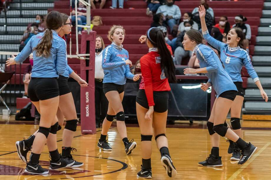 Lumberton players celebrate a point. The Lady Raiders volleyball team traveled up the road to take on the Lady Tigers of Silsbee. Photo made on October 13, 2020. Fran Ruchalski/The Enterprise Photo: Fran Ruchalski/The Enterprise / © 2020 The Beaumont Enterprise