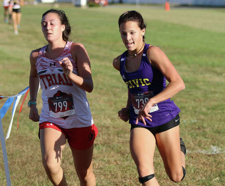 CM's Avari Combes (right) pushes past Triad's Kailey Peterson with about 50 yards left in the Mississippi Valley Conference girls cross country meet Tuesday at Mascoutah Middle School. Combes finished 21st with Peterson in 22nd. Photo: Greg Shashack | The Telegraph
