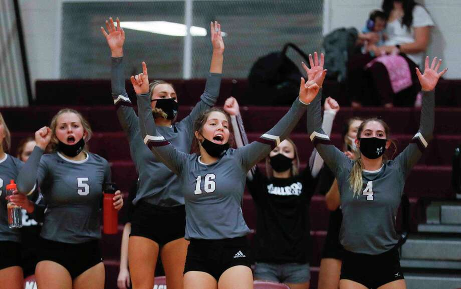 In this file photo, Magnolia players react after a point during the first set of a District 19-5A high school volleyball match at Magnolia High School, Tuesday, Oct. 6, 2020, in Magnolia. Photo: Jason Fochtman, Houston Chronicle / Staff Photographer / 2020 © Houston Chronicle