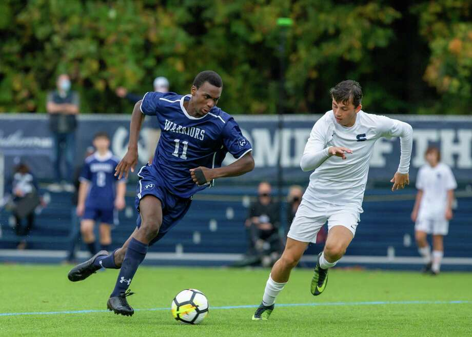 Nathan Bennett and the Wilton boys soccer team will be able to play for an FCIAC division title this fall. Photo: Gretchen McMahon / For Hearst Connecticut Media
