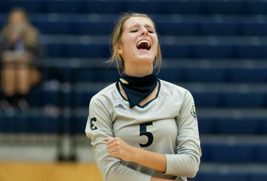 Lake Creek defensive specialist Reese Micklos (5) reacts after her team scores during the first set of a District 20-5A volleyball match at Lake Creek High School against Porter in Montgomery, Tuesday, Oct. 13, 2020. Photo: Gustavo Huerta, Houston Chronicle / Staff Photographer / 2020 © Houston Chronicle