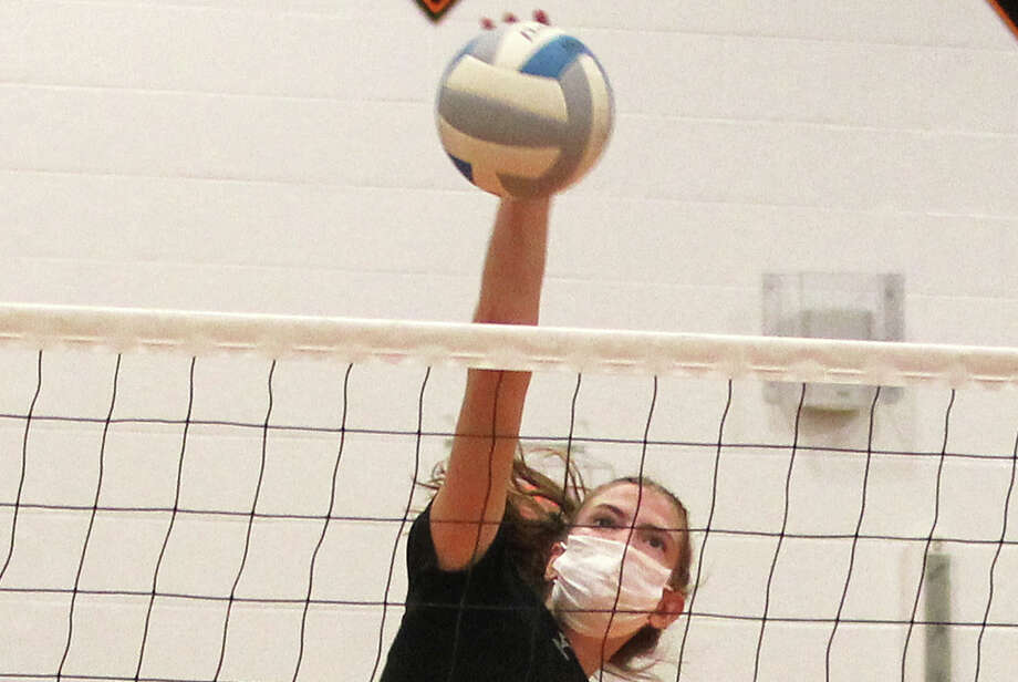 Ubly's Lindsey Guza (19) set a school record with 34 attack kills as the Bearcats varsity volleyball team rallied to beat visiting Capac in four sets on Tuesday night.