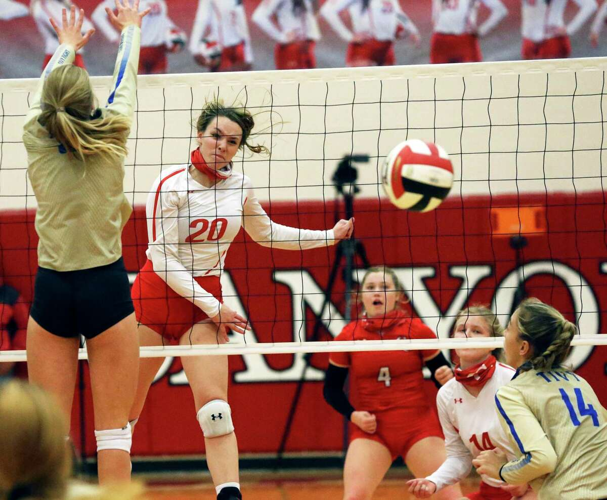 New Braunfels Canyon junior outside hitter Kyla Malone puts away one of her team-high eight kills Tuesday night.