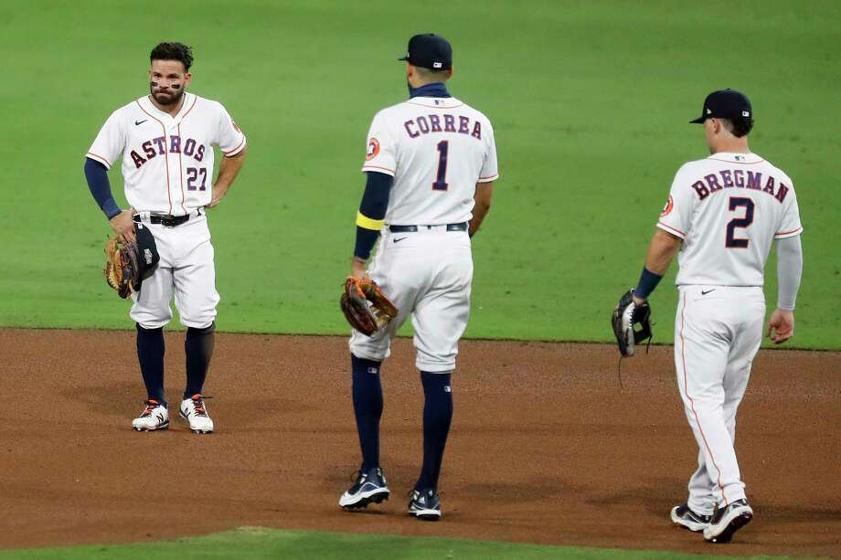 Houston Astros Jose Altuve (27) stands on the infield as teammates Carlos Correa (1) and Alex Bregman (2) walk over to him after Altuve committed an error on a grounder by Tampa Bay Rays Brandon Lowe of Game 3 of the American League Championship Series at Petco Park Tuesday, Oct. 13, 2020, in San Diego. Photo: Karen Warren, Staff Photographer / © 2020 Houston Chronicle
