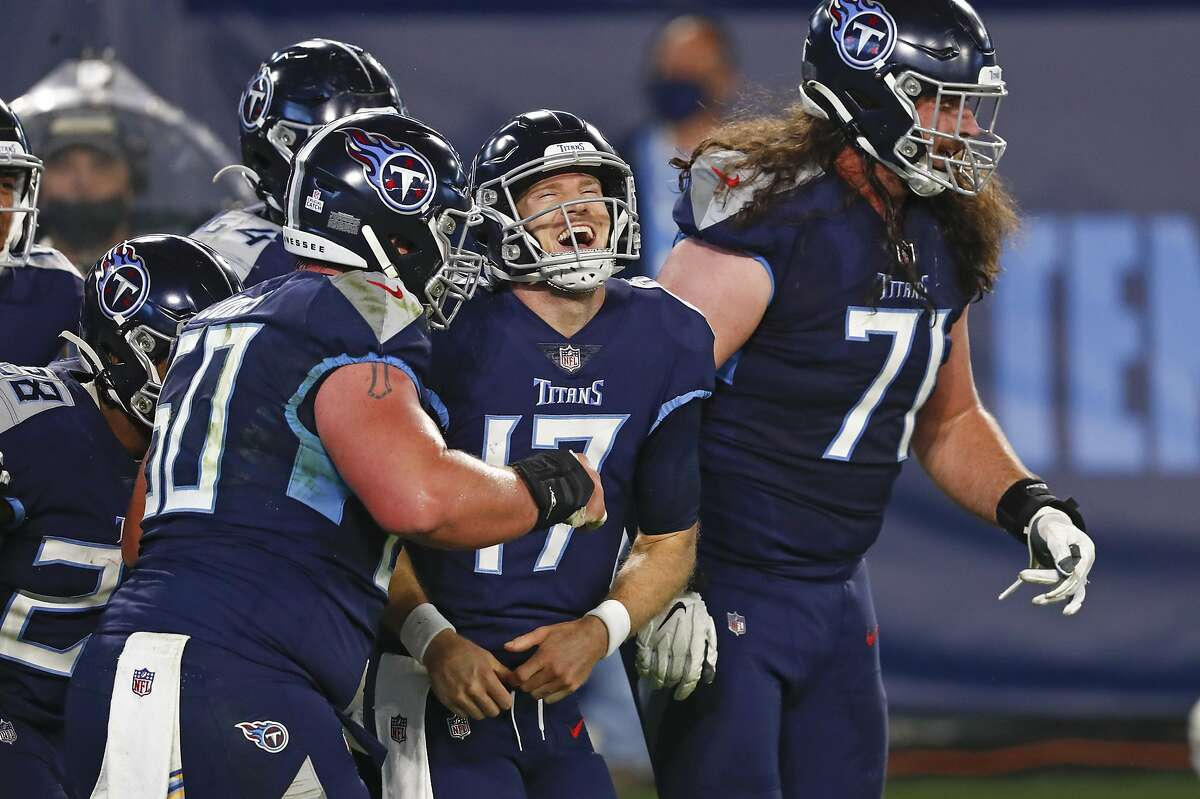 Titans quarterback Ryan Tannehill (17) celebrates after scoring on a 10-yard run against the Bills in the first half. Tannehill threw for three scores and ran for another in the rout.