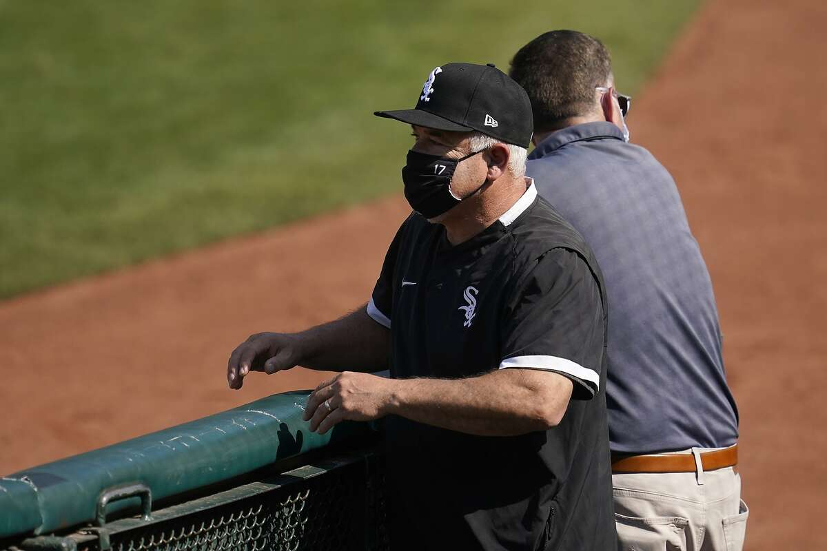Chicago White Sox manager Rick Renteria watches as players practice during a baseball workout in Oakland, Calif., Monday, Sept. 28, 2020. The White Sox are scheduled to play the Oakland Athletics in an American League wild-card playoff series starting Tuesday. (AP Photo/Jeff Chiu)