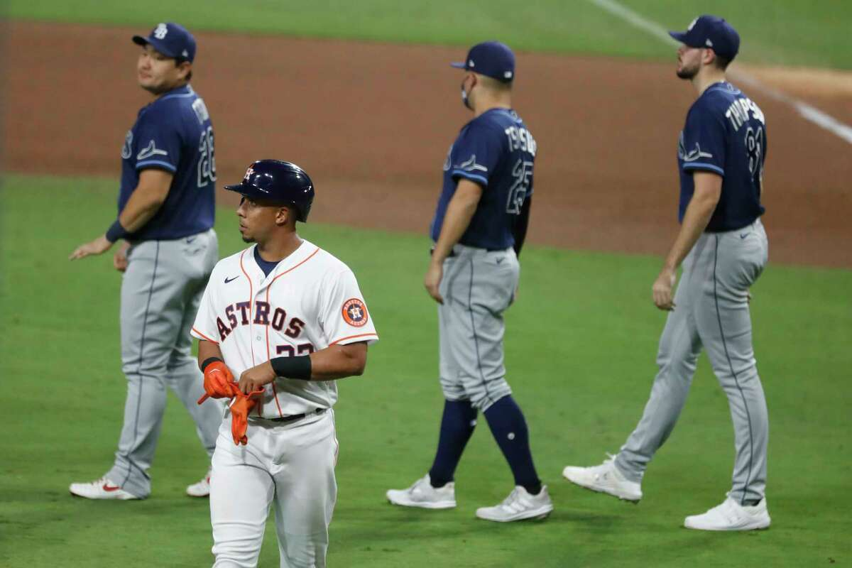 Houston Astros Michael Brantley (23) walks off the field after flying out Tampa Bay Rays Manuel Margot to end Game 3 of the American League Championship Series at Petco Park Tuesday, Oct. 13, 2020, in San Diego.