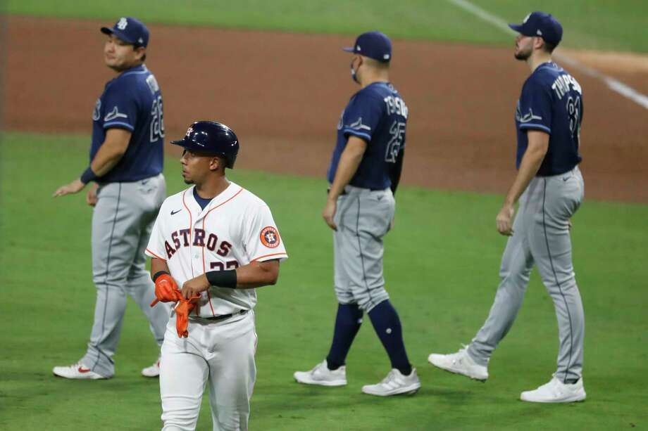 The Astros and Michael Brantley, walking back to the dugout after making the final out of Game 3 on Tuesday at Petco Park, have been constantly cracking at the worst times in the ALCS. Photo: Karen Warren, Houston Chronicle / Staff Photographer / © 2020 Houston Chronicle