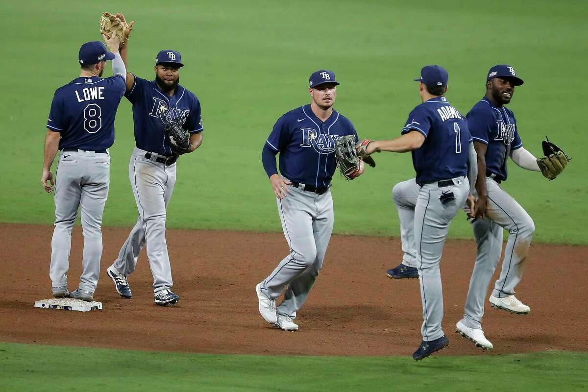 Tampa Bay Rays players celebrate their 5-2 win over the Houston Astros in Game 3 to take a 3-0 lead in the American League Championship Series at Petco Park Tuesday, Oct. 13, 2020, in San Diego.