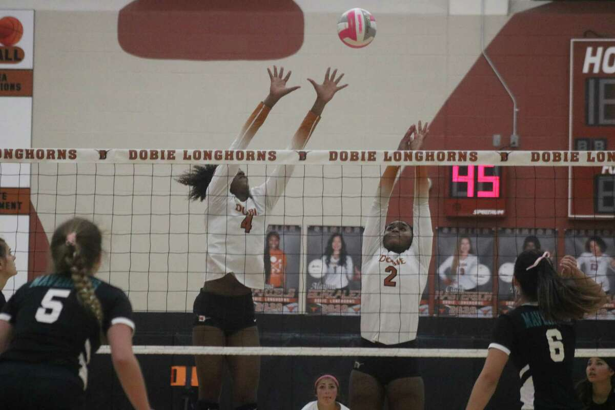 Dobie's Keasia Robinson (4), who led the match in blocks, falls short of stuffing this ball Tuesday night.