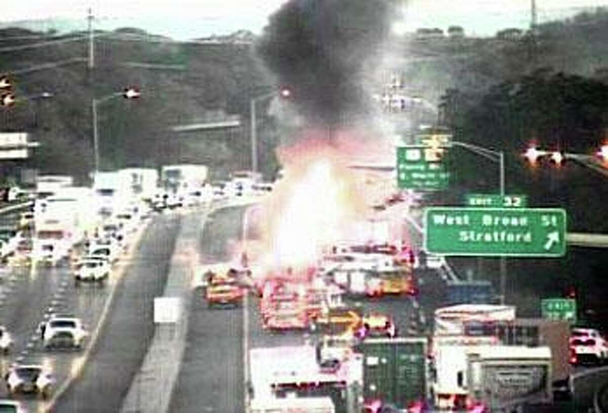 A tractor-trailer fire on Interstate 95 in Stratford, Conn., on Wednesday, Oct. 14, 2020.
