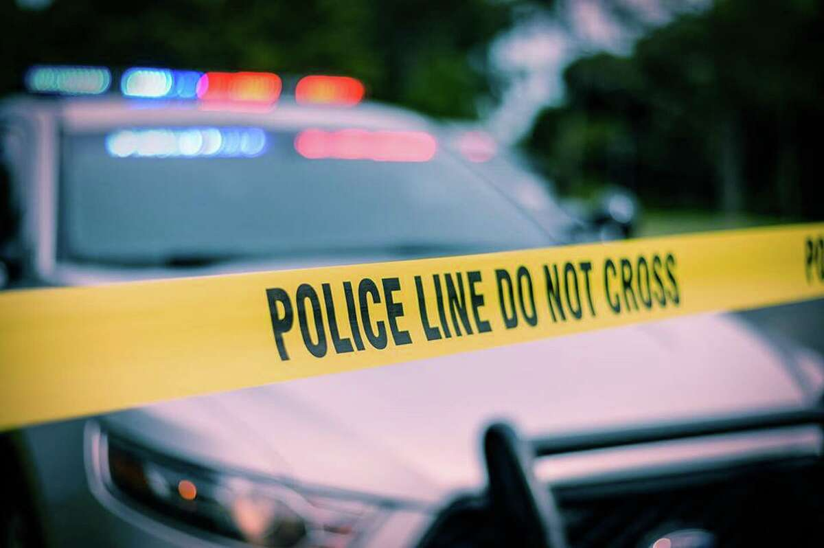 File photo of a Connecticut State Police cruiser behind police tape.