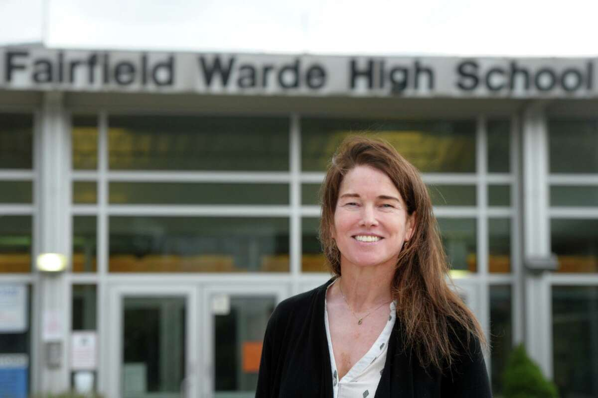 History teacher Margaret Murphy poses in front of Fairfield Warde High School, in Fairfield, Conn. Oct. 7, 2020. Murphy has received the University of Chicago Outstanding Educator Award.