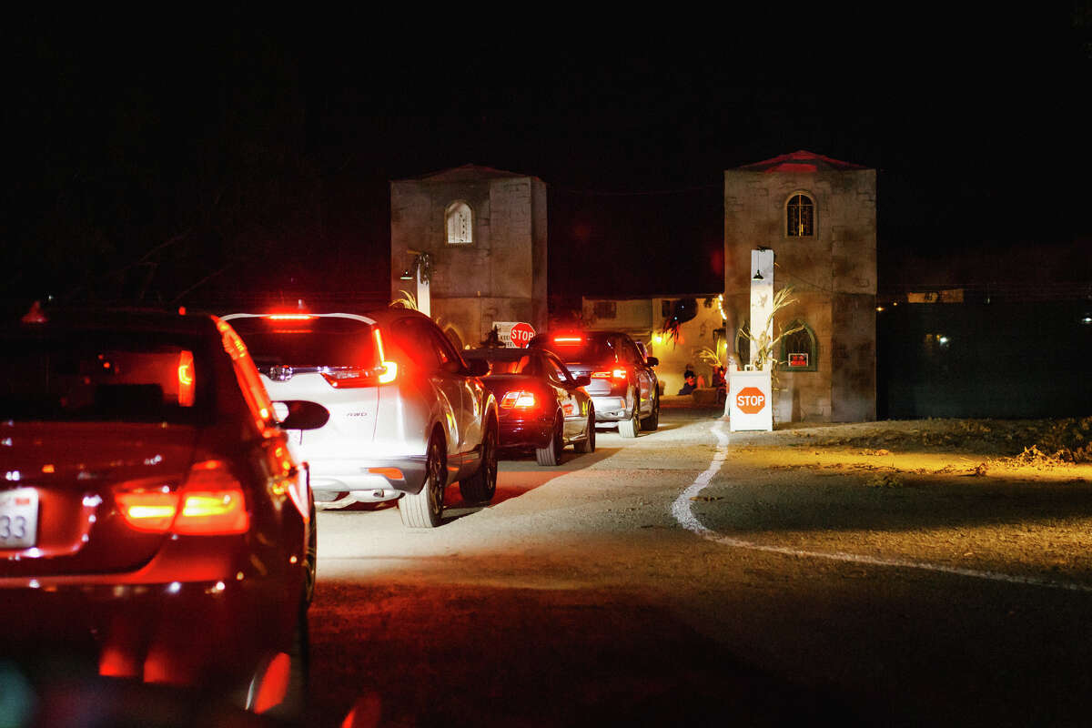 Cars line up to go inside the Pirates of Emerson drive-through haunted attraction at the Alameda County Fairgrounds in Pleasanton.