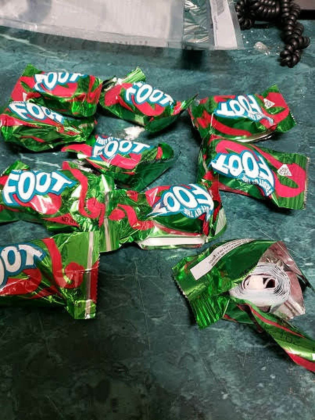 Police said they arrested a Troy man after they caught him with crack cocaine hidden in bags of candy.