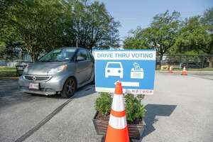 A drive-thru for voters at the Houston Food Bank, which is operating an early voting site for the first time Tuesday, Oct. 13, 2020, in Houston.