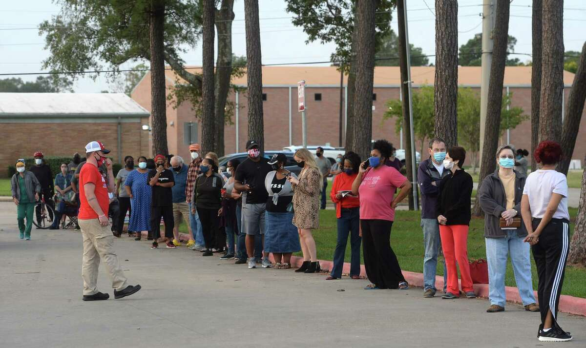 A long line stretched along the drive at Rogers Park, extending onto Gladys Avenue, before polls opened at 8 a.m. for the first day of early voting in Texas. Photo taken Tuesday, October 13, 2020 Kim Brent/The Enterprise