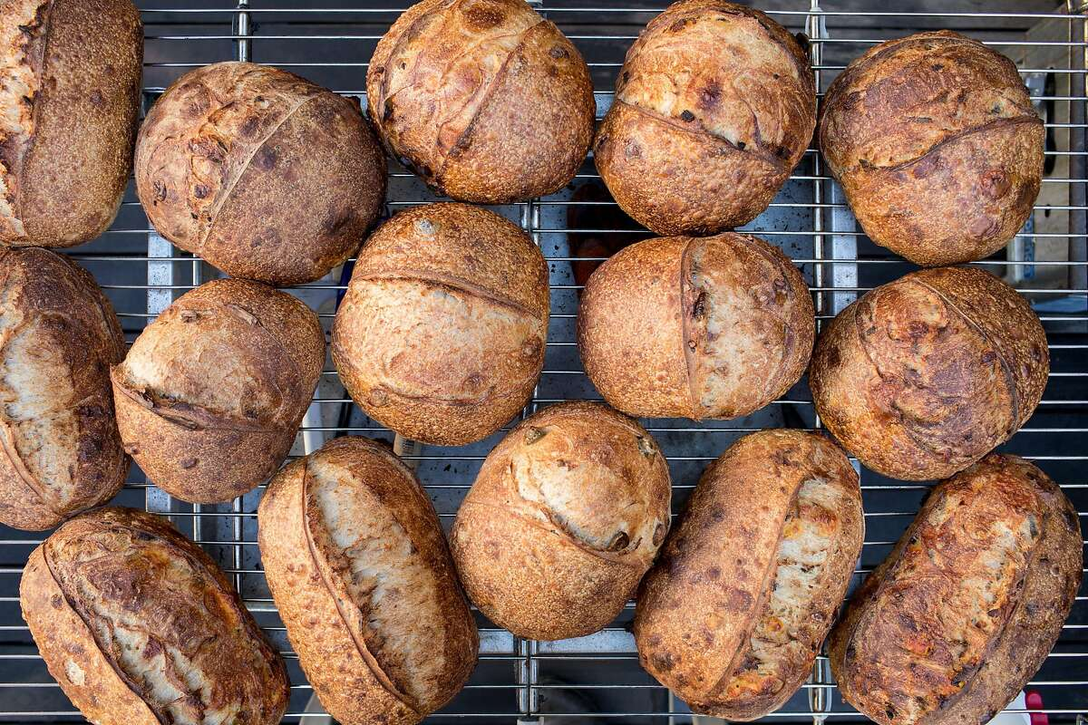 A fresh batch of Rize Up Sourdough loaves cool on a rack in Azikiwee Anderson's backyard in San Francisco.