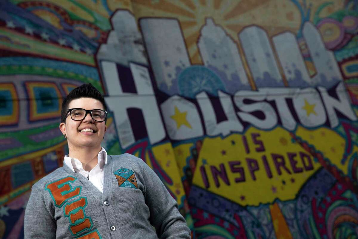 Britt Perez, 31, poses for a photograph Tuesday, Oct. 6, 2020, in downtown Houston. Perez's stepfather told her she couldn't live at home anymore at 14 because she was dating girls. Now, as a mentor at Grace Place, a nonprofit that helps teens and young adults experiencing homelessness, Perez says she is seeing LGBTQ+ youth struggling to survive in the novel coronavirus pandemic.