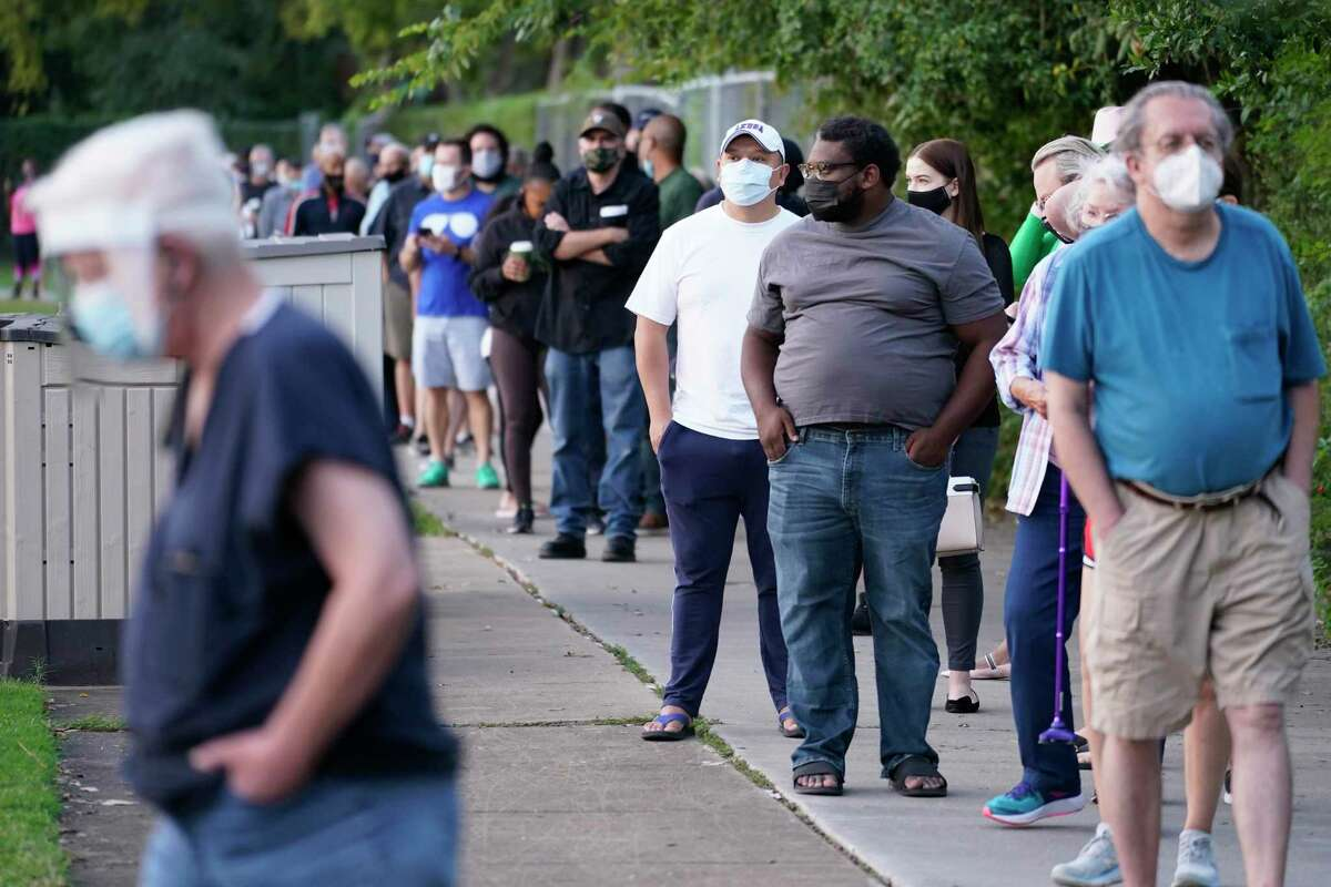 Voters wait in line Tuesday at a popular voting site on West Gray Street.