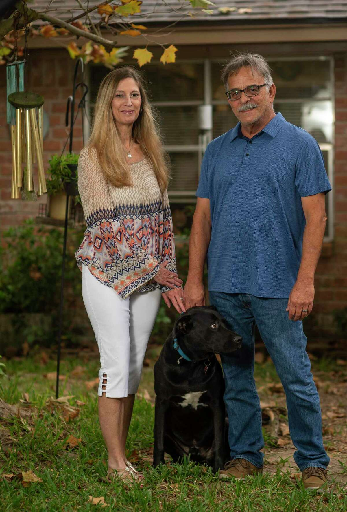 Trish Miata, with her husband, John, and dog, Diesel, survived a stroke known for leaving people with severe disabilities, but she was back to work and her regular exercise routine in just eight months. She credits her recovery to timely treatment, which is important to discuss right now as so many people are avoiding treatment due to fear of COVID. Through telemedicine and communication with doctors, Miata was able to have two important treatment procedures within 30 minutes of her stroke. Photographed at her home, Thursday, Oct. 8, 2020, in Houston.