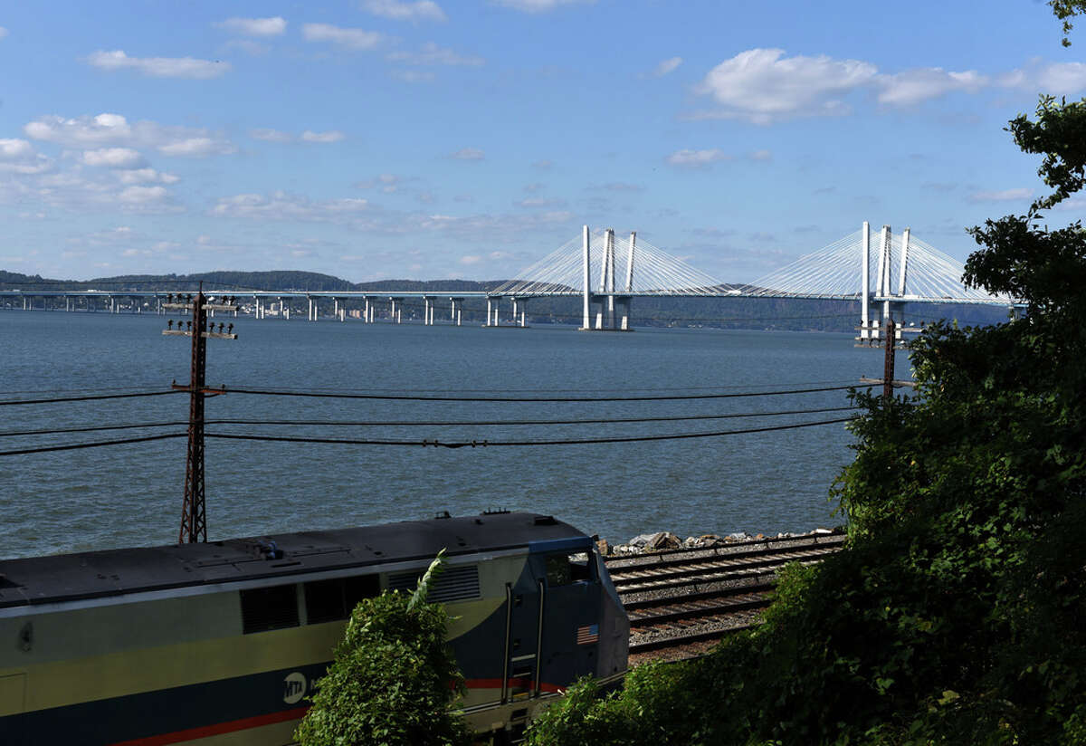 The Governor Mario M. Cuomo Bridge carrying I-287 across the Hudson River is seen from Lyndhurst Mansion as an MTA Metro North train passes by on Tuesday, Oct. 6, 2020, in Tarrytown, N.Y. (Will Waldron/Times Union)