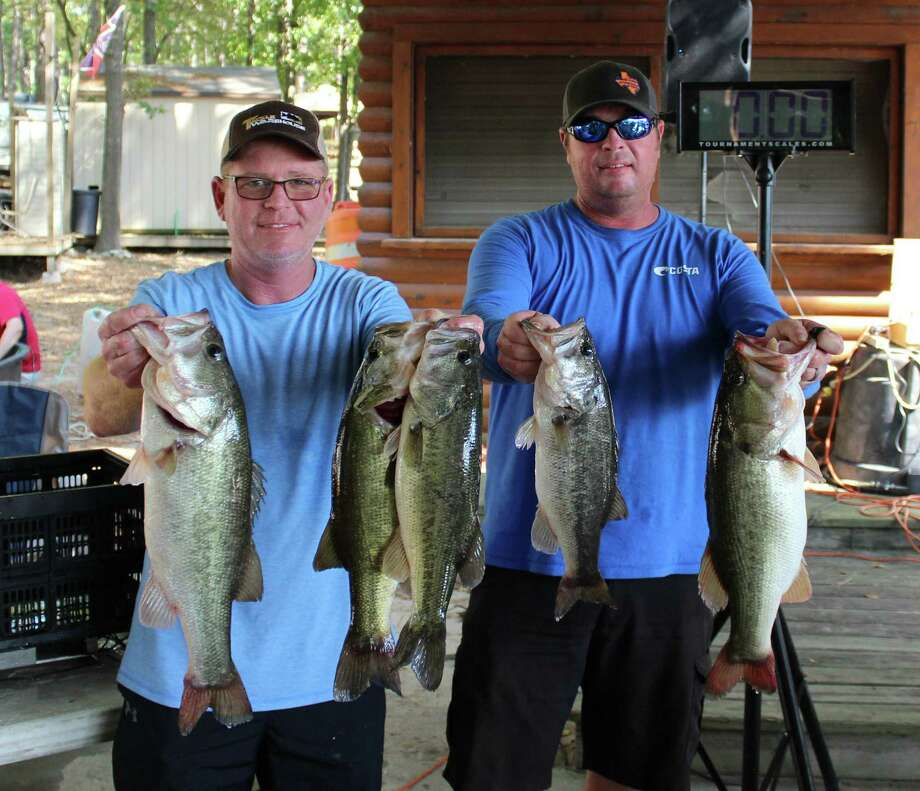 Dusty Schultz and Rusty Lawson won the Seven Coves Tournament for Kids Unlimited Foundation with a total stringer weight of 18.62 pounds. Photo: Seven Coves Bass Club