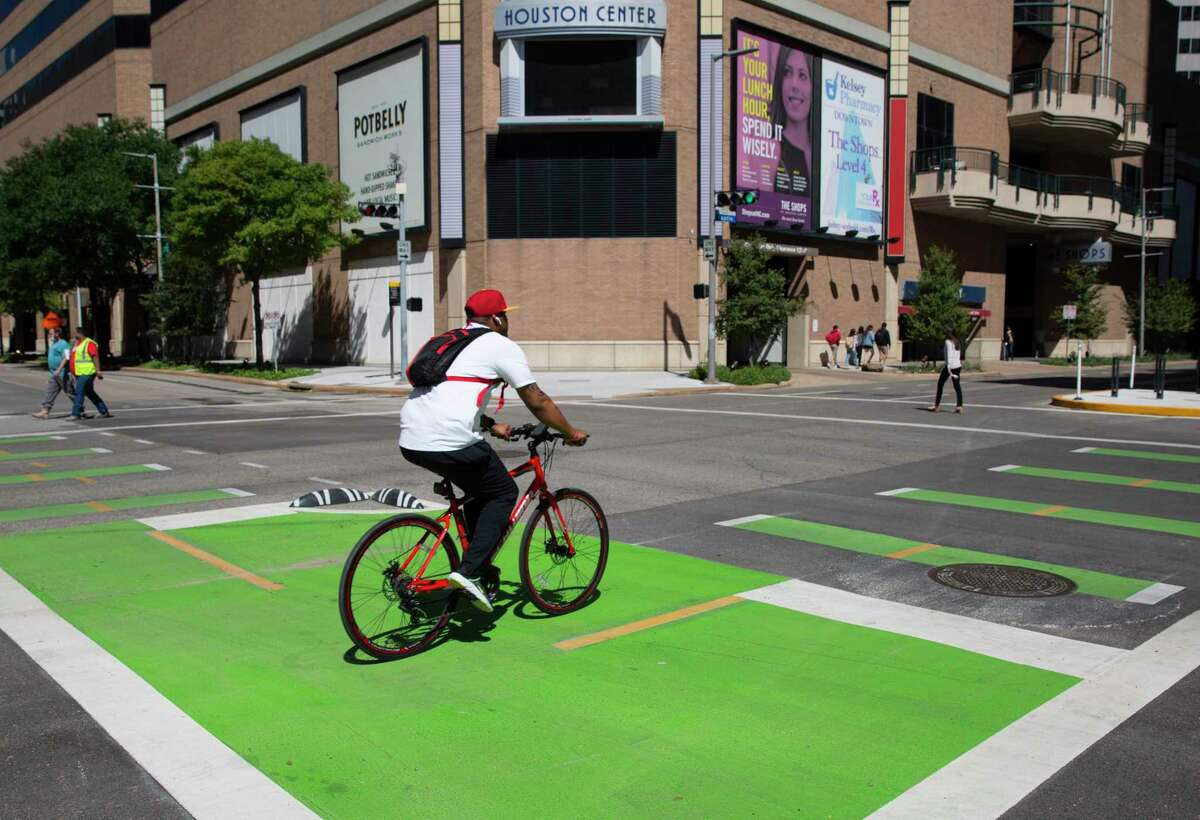 A biker passes through the intersection of Lamar and Austin bike lanes Wednesday, Sept. 30, 2020, in Downtown Houston.